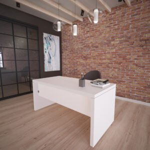 białe biurko z grubym blatem stojące obok loftowej ściany