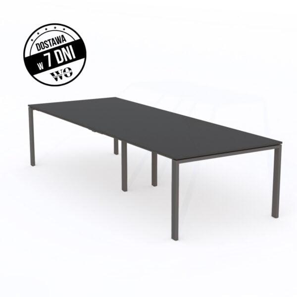 długi ciemny stół do biura stoi na białej podłodze