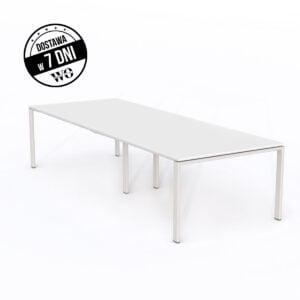 długi stół konferencyjny stoi na białej podłodze